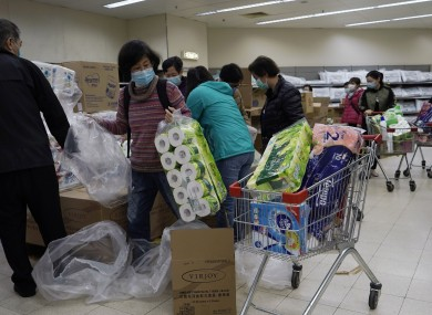 Customers wearing masks, purchase tissue papers in a supermarket in Hong Kong.