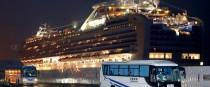 Buses carrying US passengers off the quarantined Diamond Princess cruise ship.