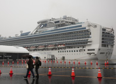 Visitors walking past the quarantined Diamond Princess cruise ship last Sunday.