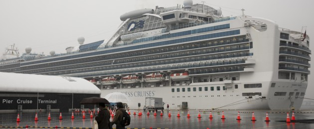 Visitors walking past the quarantined Diamond Princess cruise ship last Sunday.