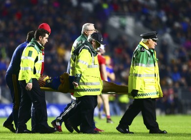 John O'Dwyer is taken from the pitch by Tipperary medical staff.