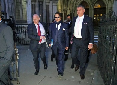 Depp leaving court today.