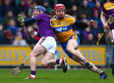 Wexford's Kevin Foley and John Conlon of Clare