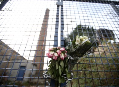 Flowers hang on the gates of the site of the former Magdalene Laundry in Donnybrook.