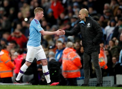 Guardiola (right) with Kevin De Bruyne.