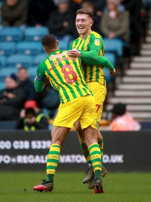 Dara O'Shea is congratulated by Jake Livermore after scoring in West Bromwich Albion's victory against Millwall.