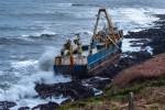 The ship washed up onshore on Sunday.