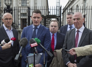 John Finucane, son of Pat Finucane, with his uncles Seamus Finucane (left of group) and Martin Finucane (right of group).