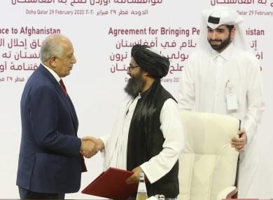 US peace envoy Zalmay Khalilzad and the Taliban's political leader Mullah Abdul Ghani Baradar.
