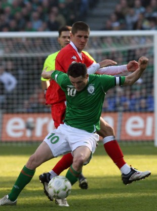 Carl Robinson tangling with Robbie Keane during the European Championship qualifier between the Republic of Ireland and Wales at Croke Park in March 2007.