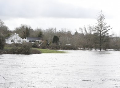 O'Briens Bridge in Co Clare just down river from the Parteen weir where the Shannon has burst its banks on the Limerick side near the village of Montpelier.