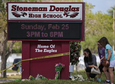 Mourners lay flowers following the shooting at Marjory Stoneman Douglas High School in February 2018.