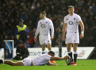 Owen Farrell stands over a kick in awful conditions.