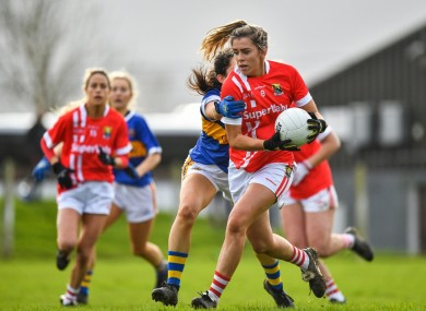 Maire O'Callaghan of Cork is tackled by Tipperary's Roisin Daly during their Lidl Ladies National Football League Div 1 Round 2 match in Clonmel. Photo by Eóin Noonan/Sportsfile