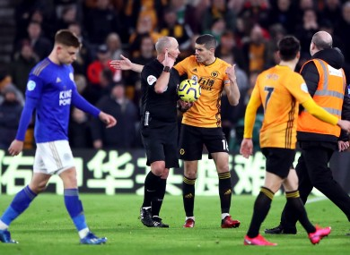 Conor Coady remonstrates with referee Mike Dean at half-time, following the disallowing of Wolves' goal.