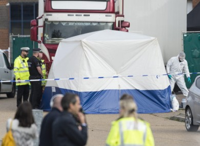 Police officers at the scene in October where the bodies were found.