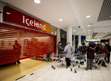 Shoppers waiting at the Iceland store in the Kennedy Centre, Belfast, to open early for a dedicated shopping session for older people