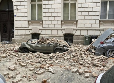 A car is crushed by falling debris after the earthquake in Zagreb, Croatia.