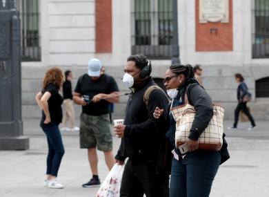 People wearing face masks on the streets of Madrid.