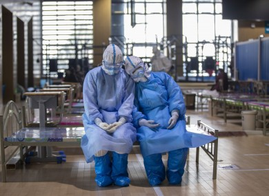 Two medical staff at the Wuchang temporary hospital in Wuhan