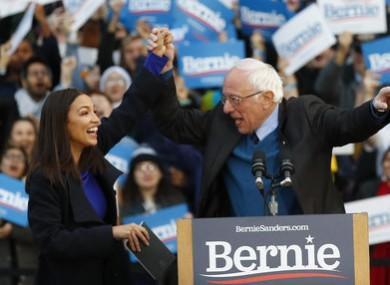Alexandria Ocasio-Cortez introduces Bernie Sanders on stage in Michigan.