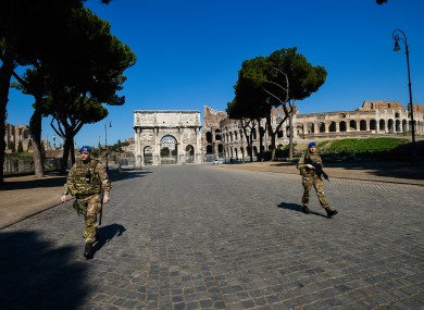 Italian army in front of the Colosseum and Arch of Constantine