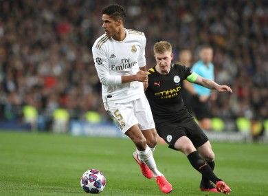 Raphael Varane and Kevin De Bruyne in action in the first leg meeting between Madrid and City.