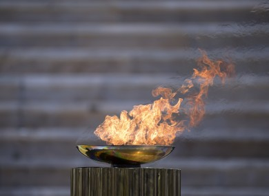 The Olympic flame burns in a cauldron during the Olympic flame handover ceremony for the 2020 Tokyo Summer Olympics.