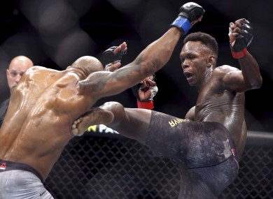 Yoel Romero is kicked by Israel Adesanya during the second round of their UFC 248 fight.