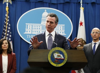 California Governor Gavin Newsom speaks to reporters about the state's response to the coronavirus during a news conference in Sacramento