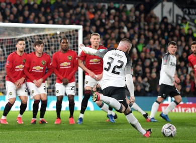 Wayne Rooney takes a free-kick against Manchester United