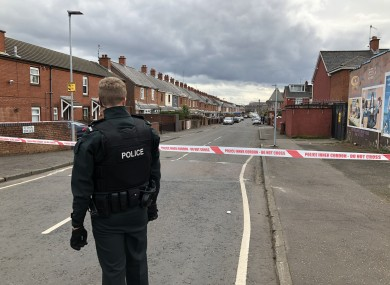 Police at the shooting in the Ardoyne yesterday.