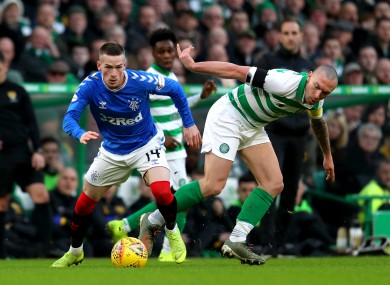 Ryan Kent of Rangers tangles with Celtic's Scott Brown during the Scottish Premiership game between the clubs in December.