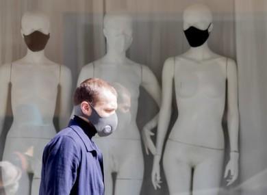A man in Berlin wears a mask.