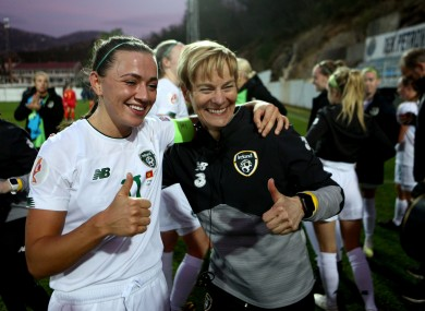 Katie McCabe and Vera Pauw celebrate after Ireland's win in Montenegro.