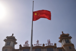 A flag at half mast in Beijing as China continues its battle against the Covid-19 virus.