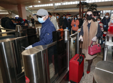 Passengers check in at the Wuhan Railway Station in Wuhan
