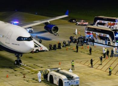 Passengers board plane to Australia.