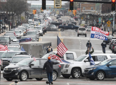 Protestors, from their cars and on foot, surround the State Capitol during ''Operation Gridlock'' in Lansing, Michigan.