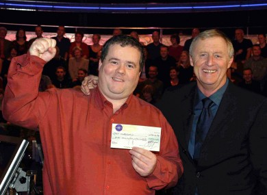 Chris Tarrant congratulates Pat Gibson, who won £1 million in 2004.
