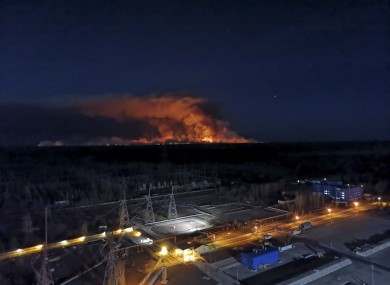 In this photo taken from the roof of Ukraine's Chernobyl nuclear power plant late Friday, a forest fire is seen burning near the plant inside the exclusion zone