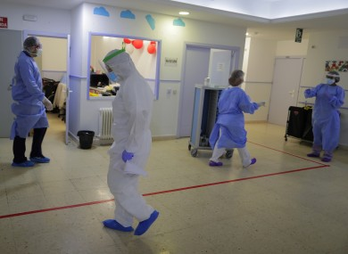 Health worker wearing protective suits to protect from coronavirus work at a nursing homes in Madrid, Spain