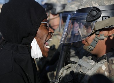 A protester yells at a member of the Minnesota National Guard.