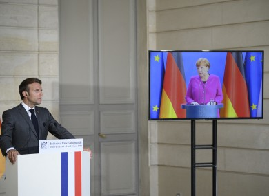Macron (in Paris) giving a press conference with Merkel (in Berlin) earlier today.