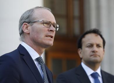 Taoiseach and Fine Gael leader Leo Varadkar (right) and Tánaiste and Fine Gael deputy leader Simon Coveney speak to the media at Government Buildings on 15 June.