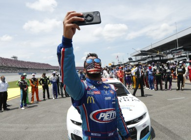 Drivers rally around Wallace yesterday.