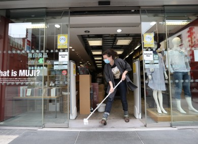 Darcey Skelly cleaning MUJI in Dublin city centre ahead of reopening on Monday.