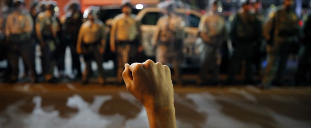 A protester raises his fist during a rally in Las Vegas.