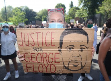 A protester at the Black Lives Matter rally outside the US Embassy in Dublin on Monday.
