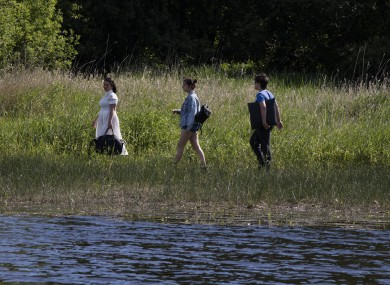 People enjoying a stroll by the Blessington Lakes on Monday.